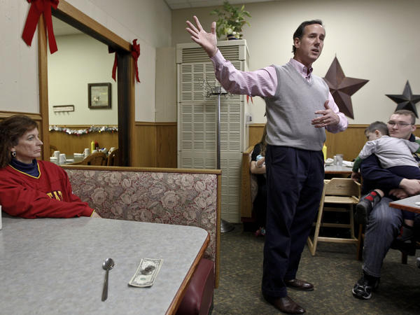 Former Pennsylvania Sen. Rick Santorum speaks Tuesday at the Lincoln Cafe in Belle Plaine, Iowa. Among GOP candidates, Santorum had the state to himself on Tuesday.