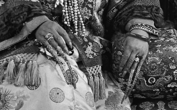 This close-up shows Cixi's gold filigreed fingernail covers, which were traditionally worn in the Qing court.