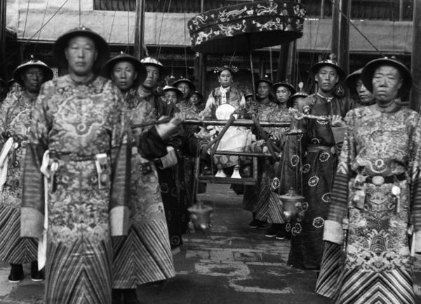 Cixi sits in a sedan chair, surrounded by eunuchs, circa 1903-04. Rumor has it that Cixi bribed the eunuchs to get better access to the emperor. Out of dozens of concubines, Cixi was the only one to bear a child.