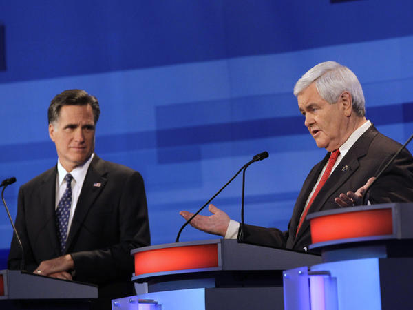 Mitt Romney and Newt Gingrich at a Republican presidential debate in Sioux City, Iowa, Thursday, Dec. 15, 2011.