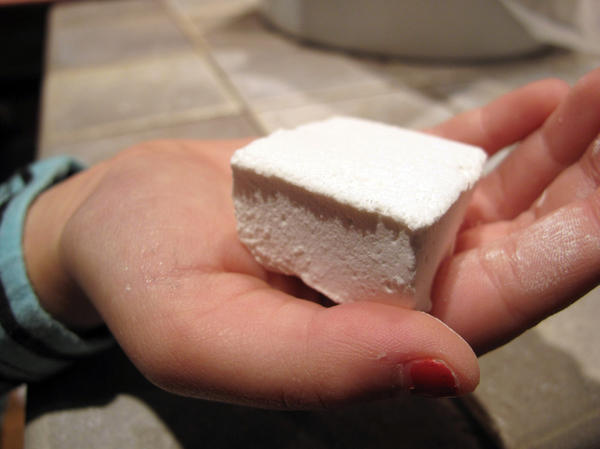 Reese says that you won't save money by making your marshmallows from scratch, but the results will be worth it. Above, a young taste-tester holds a homemade marshmallow.
