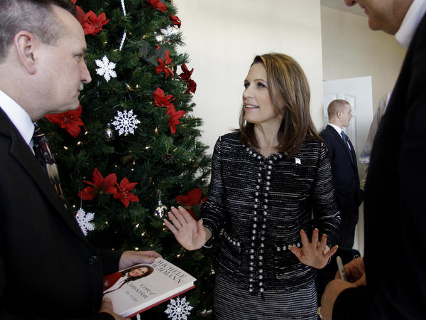 Republican presidential candidate Rep. Michele Bachmann visits with Pastor Marvin Smith III at the Harvest Baptist Church on Dec. 18 in Fort Dodge, Iowa.