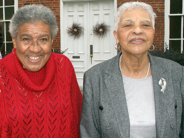 Sisters Ernestyne James Adams (right) and Althea James Truitt are concerned about the economy and today's political climate.