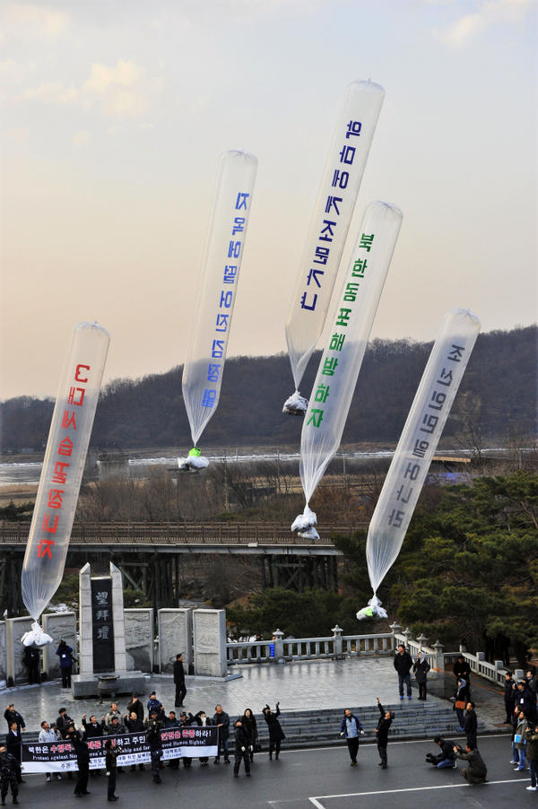 Anti-North Korea protesters release balloons containing leaflets denouncing Kim Jong-Il at Imjinggak peace park in South Korea near the DMZ on Wednesday, Dec. 21.