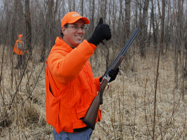 Republican presidential candidate Rick Santorum celebrates after shooting a bird at Doc's Hunt Club in Adel, Iowa on Dec. 26.