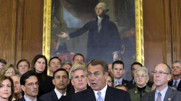 House Speaker John Boehner, surrounded by Republican House members, speaks during a news conference in Washington last week. The House initially rejected a plan to extend a tax cut for two months to buy time for talks on a full-year renewal. It later compromised — a rare event in 2011.