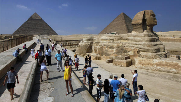 Tourists visit the Sphinx and the Pyramids of Giza near Cairo. Tourist numbers have plummeted this year with the political turmoil in Egypt. Now, some Islamist politicians are proposing rules that could discourage visitors.