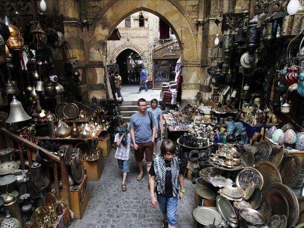 Foreign tourists stroll through the Khan el-Khalili market in Cairo.