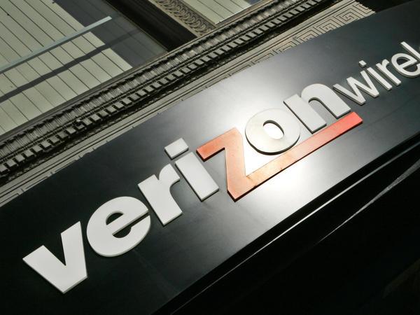 The Verizon Wireless logo hangs over a store in Portland, Ore.
