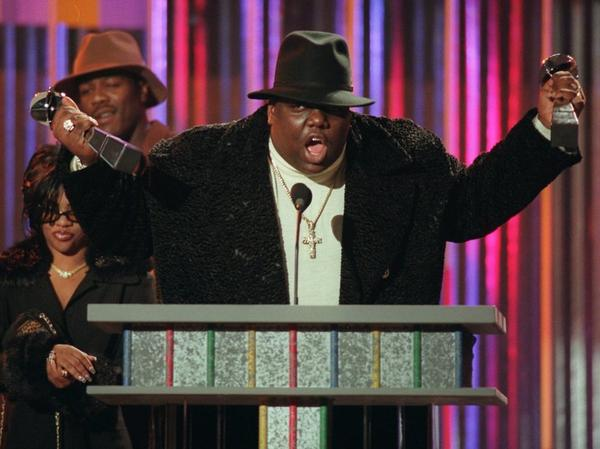 """The word """"Hater"""" — as it's often used today — is derived from the term """"Player Hater,"""" a phrase popularized by late rapper Notorious B.I.G., shown here clutching his Billboard Music Awards in 1995."""