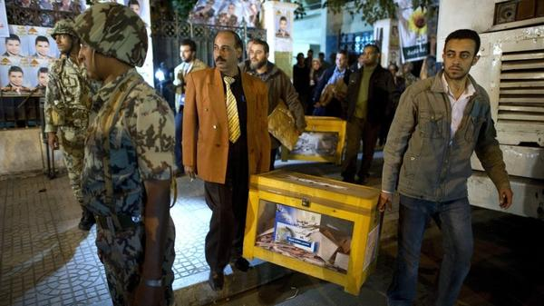 Egypt is holding parliamentary elections, but the military remains the most powerful force in the country. Here, election officials take away ballot boxes from a polling station in Cairo on Nov. 29, 2011.