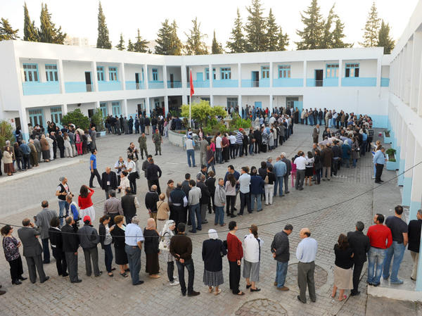 Tunisians have elected an assembly to write a new constitution. Voters are shown here on Oct. 23, 2011, outside a polling station in the capital Tunis.