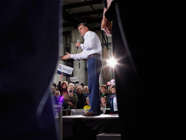 Former Massachusetts Gov. and Republican presidential candidate Mitt Romney addresses supporters during a campaign rally at the Weber Paper Company Monday in Dubuque, Iowa.