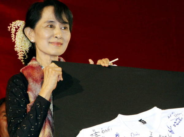 Myanmar has set parliamentary by-elections for April 1, scheduling a highly anticipated vote that will return dissident Aung San Suu Kyi and her National League for Democracy to mainstream politics after two decades. Here, Suu Kyi attends a fundraising event for the party in Yangon, Myanmar, last month.