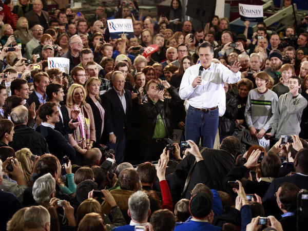 Former Massachusetts Gov. Mitt Romney speaks at a rally in Clive, Iowa, on Monday.