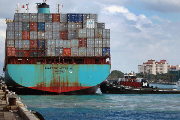 A container ship prepares to leave the Port of Miami in 2010. Plans are under way to deepen the port to 50 feet to attract bigger ships coming from the Panama Canal, but they've recently been put on hold after environmental groups filed a petition.