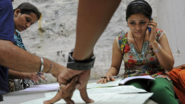 Competition for admission to India's top school, Delhi University, is particularly fierce. Here students fill out forms at the Arts Faculty in New Delhi, India, on June 21.