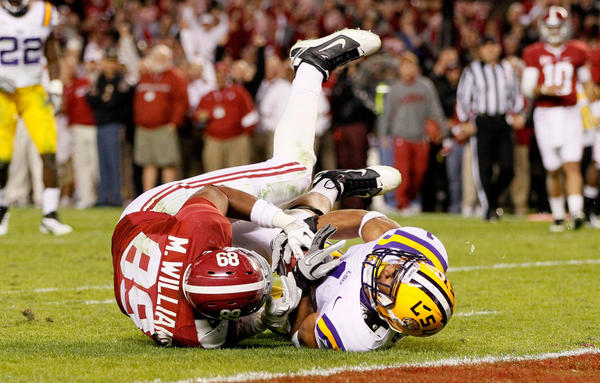 <strong>Not Giving An Inch:</strong> You can expect to see lots of close contact in Monday's BCS national title game. Here, Eric Reid of the LSU Tigers defends against Michael Williams of the Alabama Crimson Tide.