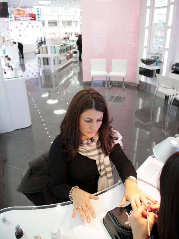 Carmen Ohotenco gets her nails done by Katherine Walker at the new Walgreens store in Chicago.