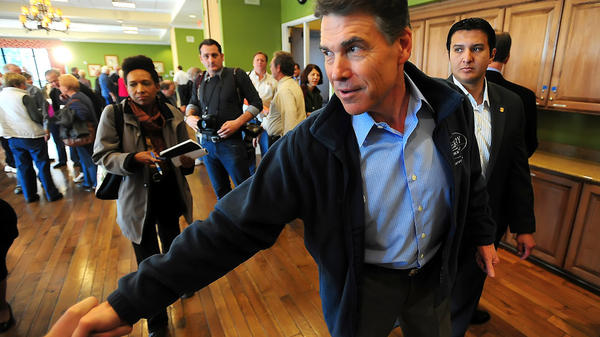 "Texas Gov. Rick Perry greets voters Jan. 10 after speaking to a town hall meeting in Indian Land, S.C. He has said that if voters want someone to sing ""Kumbaya,"" ""I'm not your guy."""