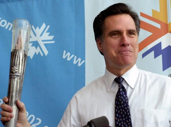 Romney, then-president of the SLOC, holds the planned Olympic torch during a news conference in February 2001 in Salt Lake City.