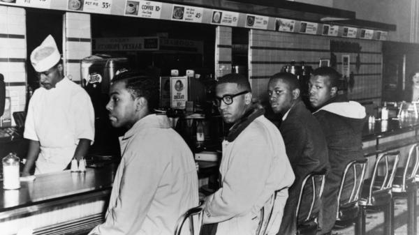 In February 1960, college students (from left) Joseph McNeil, Franklin McCain, Billy Smith and Clarence Henderson began a sit in protest at the whites-only lunch counter at a Woolworth's in Greensboro, N.C.
