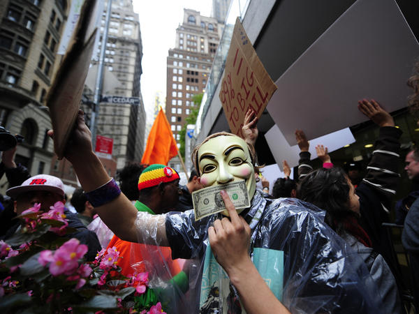 "Occupy Wall Street members stage a protest march near Wall Street in New York in October. Paul Taylor of the Pew Research Center says the movement has ""crystallized"" the idea of economic disparity."