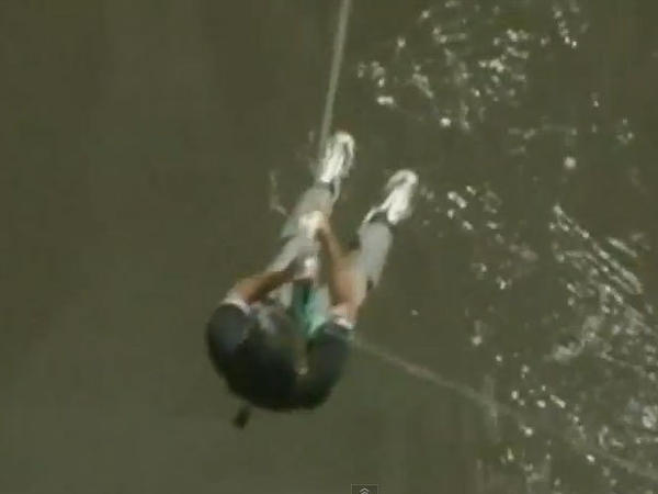 Zambia's tourism minister Given Lubinda bungee-jumped off of a bridge at Victoria Falls to invite tourists back.