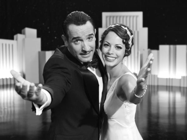 Silent Screen idol George Valentin (Jean Dujardin) and Peppy Miller (Berenice Bejo), a young and upcoming dancer, share a vivacious moment on stage in Michel Hazanavicius's film <em>The Artist.</em>
