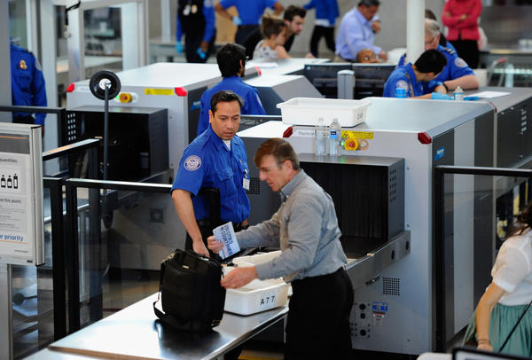 Transportation Security Administration (TSA) agents screen passengers at Los Angeles International Airport.