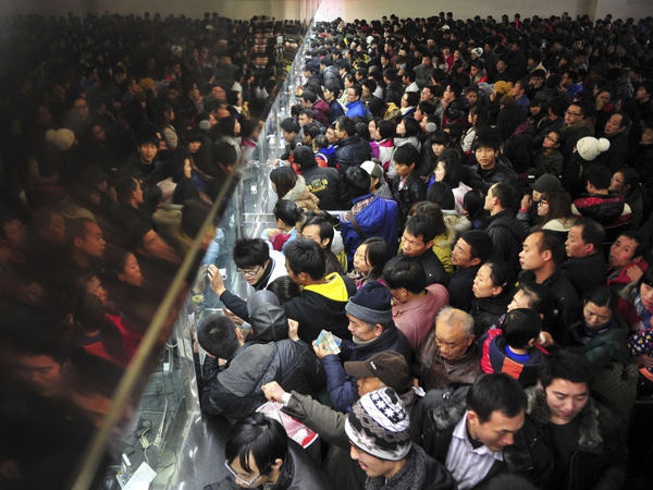 People line up to buy train tickets at Changsha Railway Station in Changsha, in southern China's Hunan province on Dec. 28, 2011. Million of Chinese are expected to cramp onto China's train network in the coming weeks to return home for the Chinese lunar new year that starts on Jan. 23, 2012.