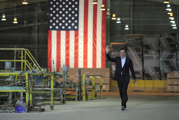 Republican presidential hopeful Mitt Romney arrives to deliver a speech ahead of the State of the Union presidential address at National Gypsum Company in Tampa, Fla. on January 24, 2012.