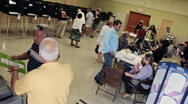 Early voters cast ballots for Florida's Republican primary in Miami on Monday.