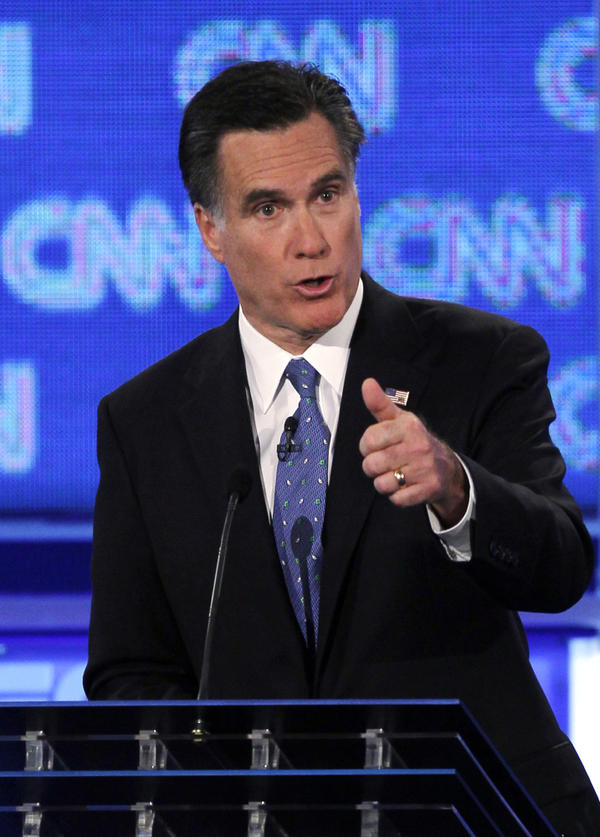 Former Massachusetts Gov. Mitt Romney offered a spirited defense of the individual mandate during Thursday night's GOP presidential candidate debate in Jacksonville, Fla.