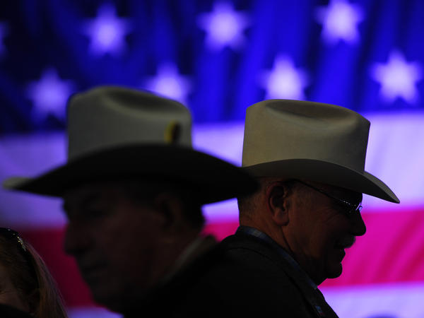 Men arrive at a campaign rally for Mitt Romney in Elko, Nev., on Friday.