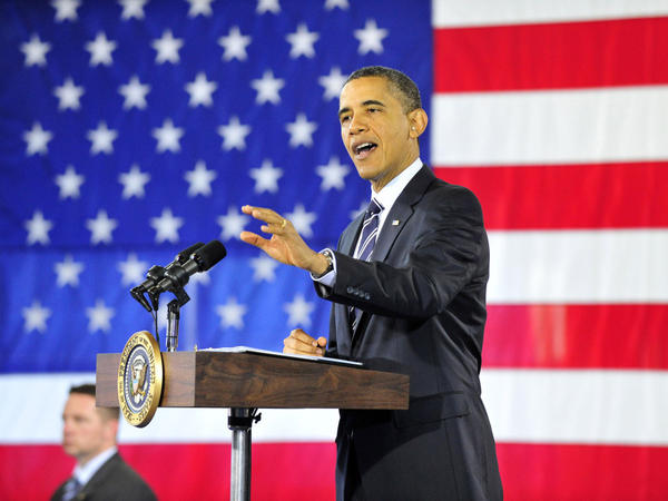 """President Obama speaks about the economy Friday in Arlington, Va. Obama says he wants to """"send a clear message to Congress: Do not slow down the recovery that we're on."""""""