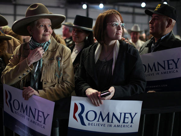 Romney supporters gather for a rally at the Elko Regional Airport in Nevada on Friday. The state holds its caucus Saturday.