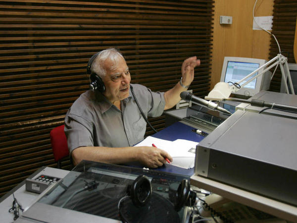Iranian-born Menashe Amir (shown here in 2006) hosts a call-in show on Israel Radio's Farsi service, one of the few forums for direct discourse between Iranians and Israelis.