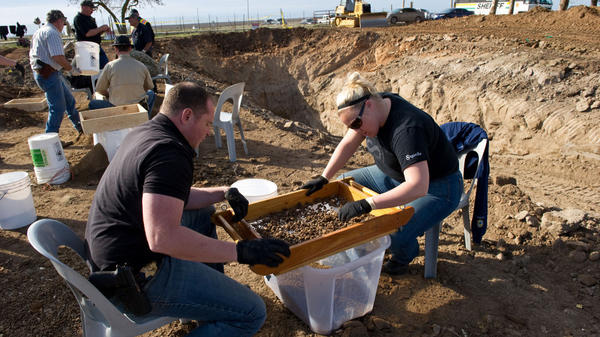 San Joaquin sheriff detectives sift for human remains that were excavated from an abandoned ranch near Linden, Calif., on Sunday. Authorities say Wesley Shermantine and Loren Herzog wantonly murdered an unknown number of victims before their arrest in 1999. Now, one of the convicted killers is leading investigators to burial sites that have yielded hundreds of bones.