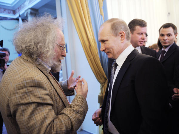 Alexei Venediktov, then editor-in-chief of Moscow Echo radio station, talks with Russian Prime Minister Vladimir Putin during an awards ceremony in Moscow, Jan.  13. Venediktov's ouster this month is seen as a sign that the Russian government may be cracking down on the independent media.