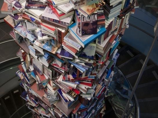 A tower of books about Abraham Lincoln as seen from the top down.