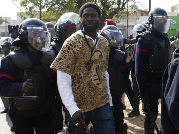 Police arrest Kilifa, a leader of Senegal's rapper-led youth movement, in Dakar on Thursday.
