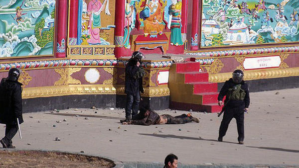 """This photo, provided to <a href=""""http://freetibet.org/"""">freetibet.org</a>, shows a man being forcibly detained by security forces in the town of Serther in Tibet following a clash with protesters and police."""