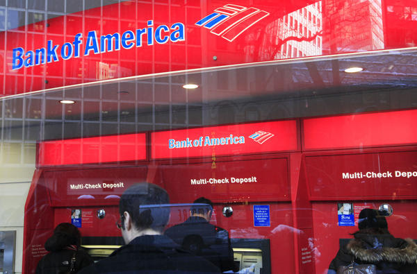 Customers use Bank of America ATMs in New York. The head of the Consumer Financial Protection Bureau says it is looking into ways to help consumers limit their exposure to banks' overdraft fees.