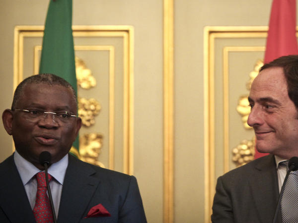 Portugal's minister of foreign affairs, Paulo Portas (right), meets with his Angolan counterpart, Georges Chikoti, during a press conference in Lisbon, Portugal, in 2010. A growing number of Portuguese workers are seeking employment in their country's former, resources-rich African colony.