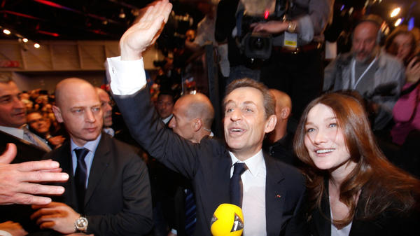 French President Nicolas Sarkozy and his wife, Carla Bruni Sarkozy, greet supporters during a campaign rally in Marseille, France, on Feb. 19.