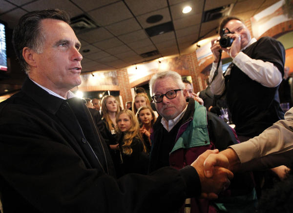 Mitt Romney greets patrons at a restaurant called The Mitt in Mount Clemens, Mich., on Friday. The candidate hasn't done as much handshaking lately, given the size of the recent primary states.
