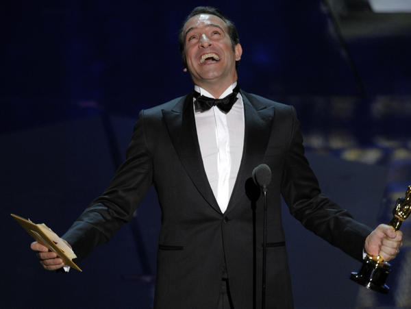 Jean Dujardin accepts the Oscar for best actor in a leading role for <em>The Artist</em> during the 84th Academy Awards on Sunday.