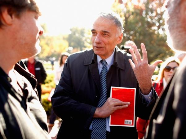 Political activist and former presidential candidate Ralph Nader talks with labor leaders at a rally Washington, D.C., on Nov. 3, 2011.