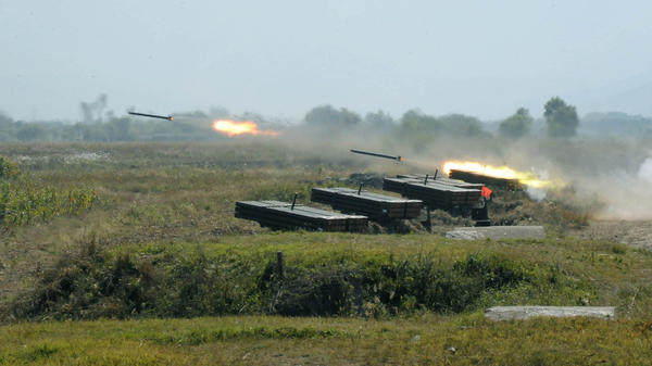 North Korea's military fires missiles during a drill in this undated photo released Oct. 6, 2010, by the Korean Central News Agency. North Korea has agreed to stop nuclear activities and allow inspections, while the U.S. says it will provide food aid to the country.
